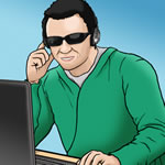 A man wearing dark glasses at a computer