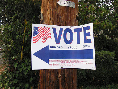 """Vote"" sign on telephone pole"